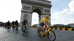 Froome seals Tour great status with third title