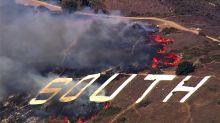 Grass Fire burning near South SF hillside sign