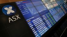 Aust shares cling to positive territory