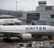 Dragged United passenger 'aggressive', officers say