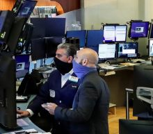 Wall Street ends down in late selloff; Facebook and China weigh