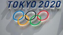 Biden backs Japan PM on holding 'safe and secure' Olympic Games