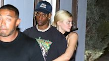 Kylie Jenner Cuddles Travis Scott as Couple Steps Out for Date Night in Malibu