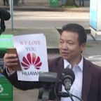 Protests outside Chinese tech official's hearing.