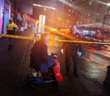 One man arrested, two more sought in deadly Seattle rush-hour shootout