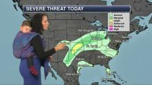 Meteorologist straps her son to her body while reporting weather forecast on live TV to raise awareness about 'baby wearing'