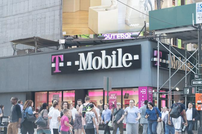 People walking by a T Mobile store in Manhattan.