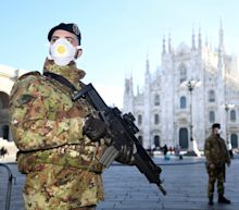 Italy sealed off entire towns and canceled major events after 400 coronavirus cases and 12 deaths made it the most infected country outside of Asia