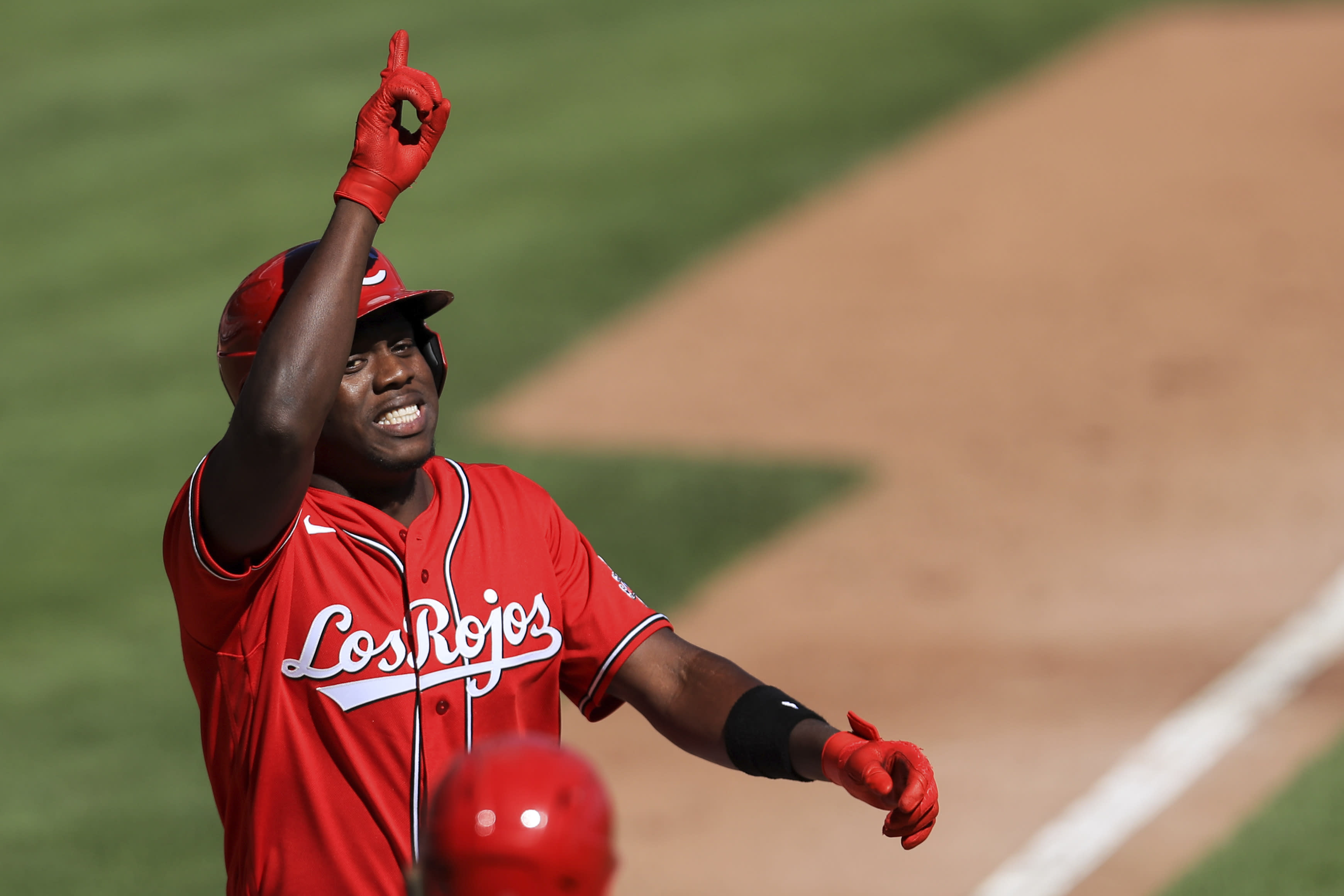Cincinnati Reds' Aristides Aquino reacts after hitting a two-run home run in the fifth inning during a baseball game against the Chicago White Sox in Cincinnati, Sunday, Sept. 20, 2020. (AP Photo/Aaron Doster)