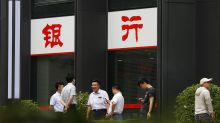 China regulators free up extra $100B for bank lending