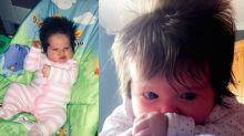 Baby born with amazing head of hair after it was so thick it was spotted on the scan