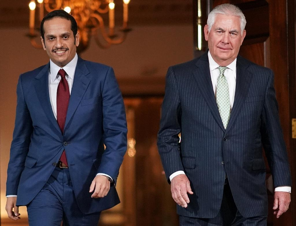 Qatari Foreign Minister Sheikh Mohammed bin Abdulrahman Al-Thani(L) heads into talks with US Secretary of State Rex Tillerson in Washington on June 27, 2017