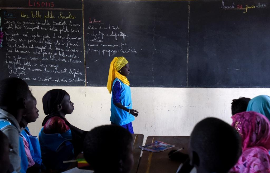 Literacy in sub-Saharan Africa hovers around 65 percent, according to UNESCO and girls lose out disproportionately (AFP Photo/SEYLLOU)