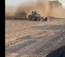 8 people were injured after a car veered out of control and plowed into a crowd at a Texas mud racing event