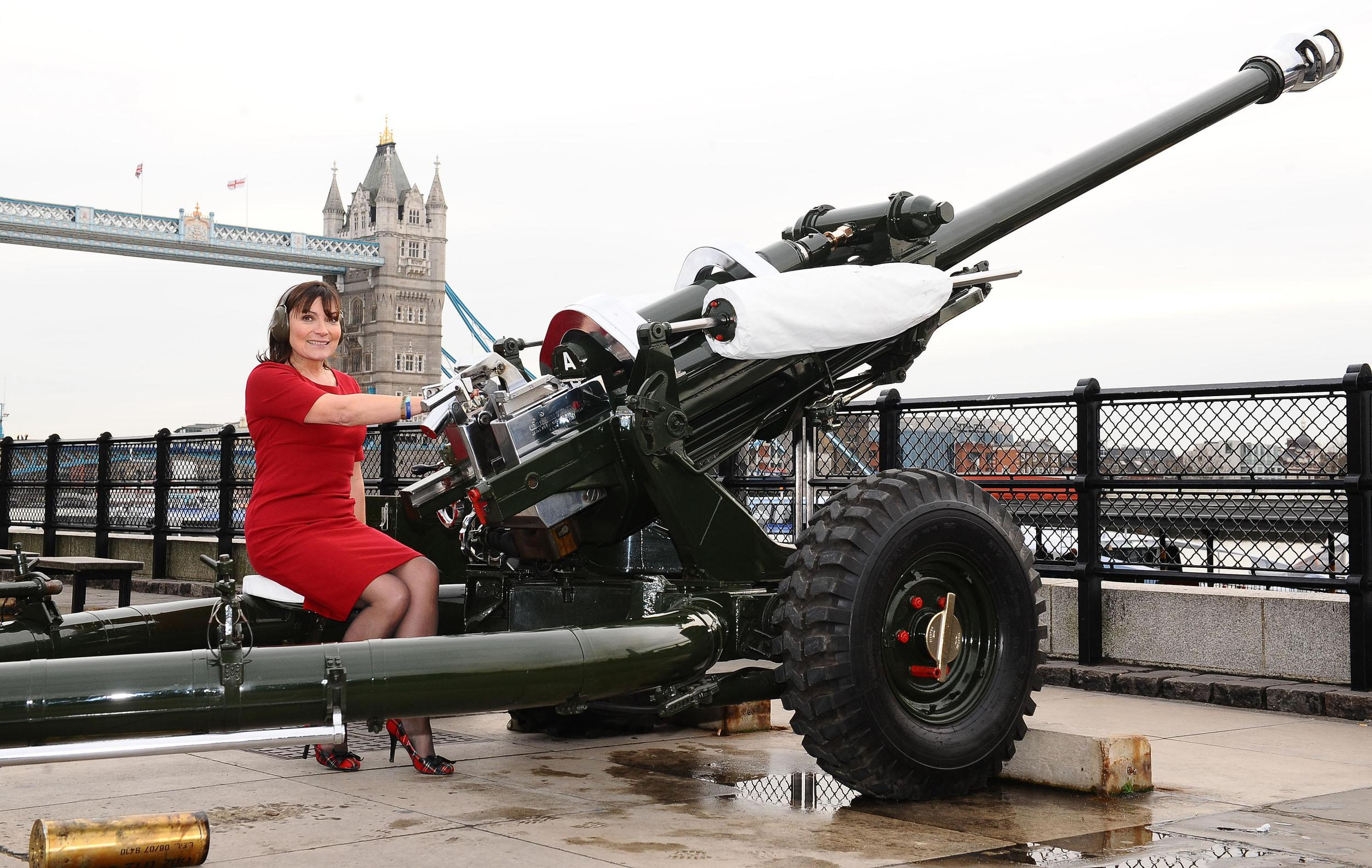 Lorraine Kelly launches the uk4u Thanks! 2011 Christmas Box campaign at the Tower of London in London, by firing the the Honourable Artillery Company Gun along side troops.