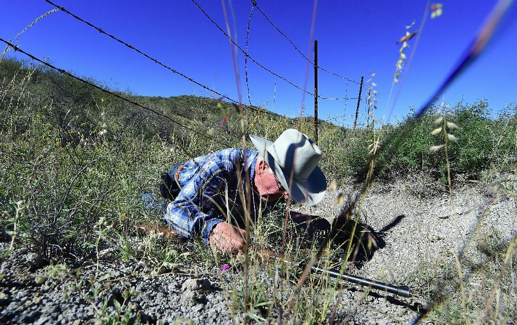 Jim Chilton demonstrates how easy it is to cross the US-Mexico border on part of his 50,000 acre cattle ranch (AFP Photo/Frederic J. Brown)