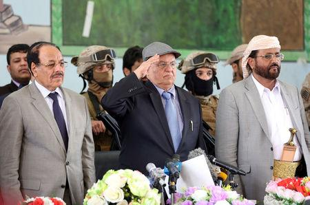 Yemen's President Abd-Rabbu Mansour Hadi salutes during a visit to the country's northern province of Marib with his deputy Ali Muhssien al-Ahmar (L) July 10, 2016. REUTERS/Ali Owidha