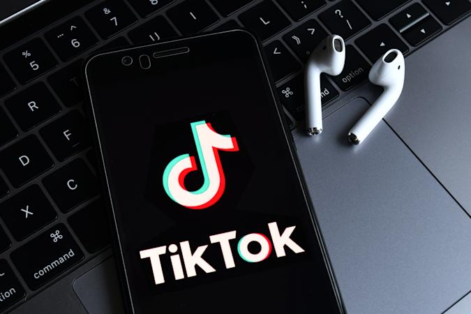 HAIKOU, HAINAN, CHINA - 2020/08/23: In this photo illustration, a TikTok logo seen displayed on a smartphone with a computer in the background. ByteDance, parent company of popular video-sharing app TikTok on Sunday confirmed it would be filing a lawsuit on Monday local time against the Trump administration over the executive order signed by President Donald Trump banning its service in the United States. (Photo Illustration by SheldonCooper/SOPA Images/LightRocket via Getty Images)