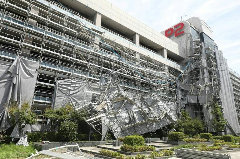 Strong winds ripped the scaffolding off some buildings (AFP Photo/jiji press)
