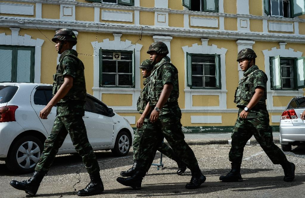 Thai soldiers march past the Military Court in Bangkok in August (AFP Photo/Lillian Suwanrumpha)