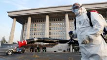 Hong Kong warns against travel to South Korea as virus spreads