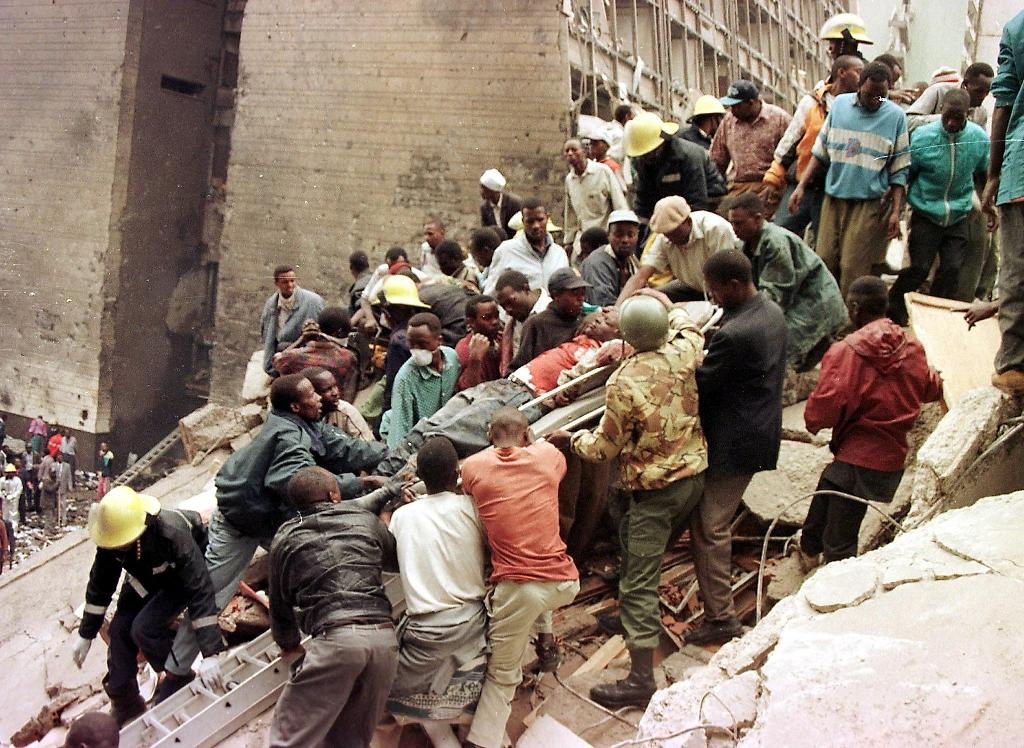 Rescue workers helped the injured at the US embassy in Nairobi after the massive blast in 1998 which left 213 dead (AFP Photo/-)