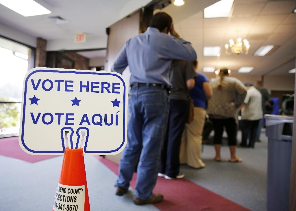 Texas' Republican authorities enacted a statute in 2011 that required voters to show one of seven types of official ID (AFP Photo/ERICH SCHLEGEL)