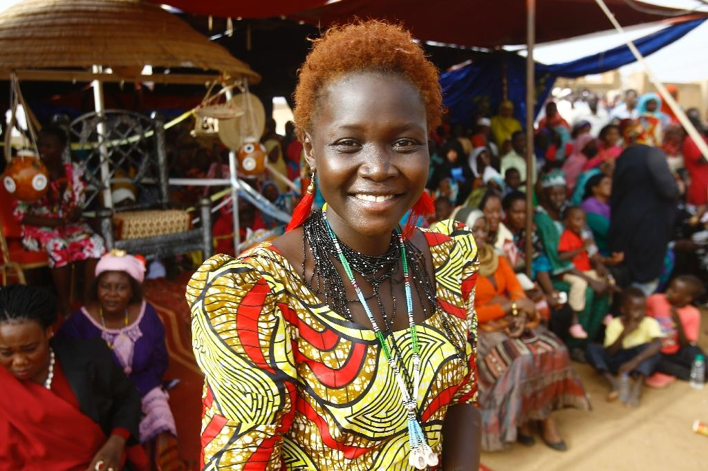 Natalina Yaqoub, a 22-year-old student crowned Nuba Mountains beauty queen, takes part in the Nuba Mountains Cultural Heritage Festival in the capital's twin city of Omdurman, Sudan on August 15, 2015 (AFP Photo/Ashraf Shazly)
