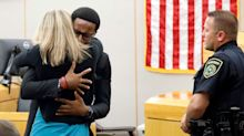 Amber Guyger: Brother Embraces Ex-Police Officer Who Shot Botham Jean And Says 'I Forgive You'