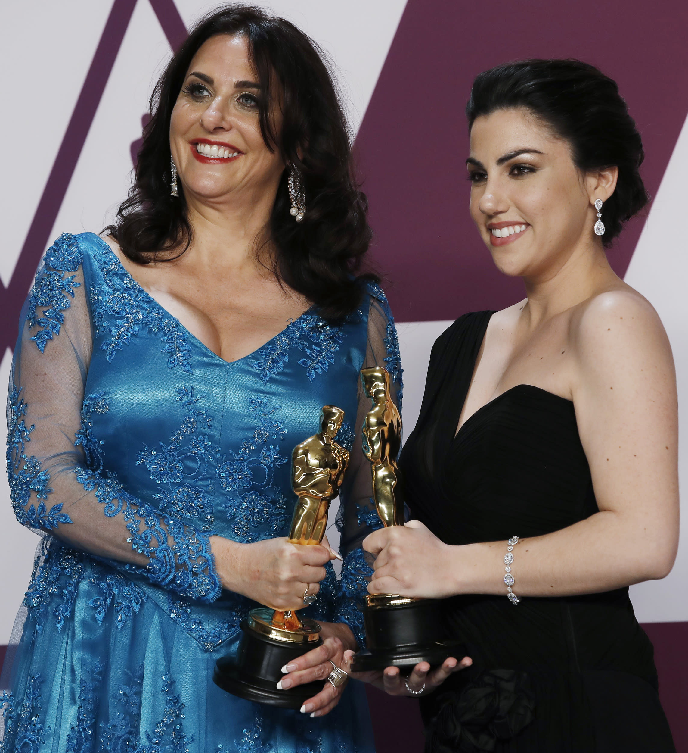 """91st Academy Awards - Oscars Photo Room - Hollywood, Los Angeles, California, U.S., February 24, 2019.  Rayka Zehtabchi and Melissa Berton pose backstage with their award for  Best Documentary Short Subject award for the film """"Period. End Of Sentence."""" REUTERS/Mike Segar"""