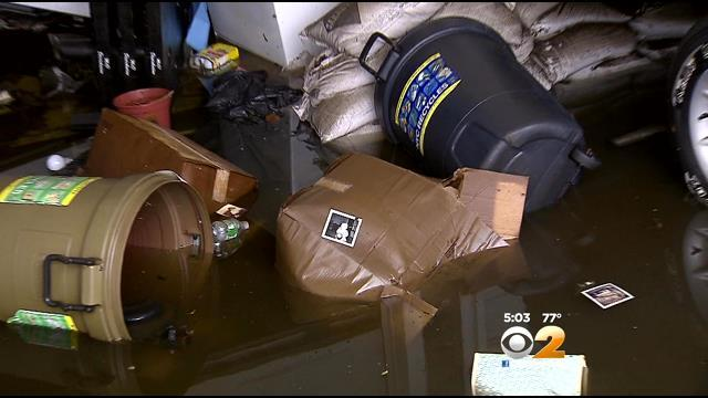Howard Beach Residents Clean Up Following Flooding
