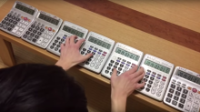 Japanese 'calculator musicians' play songs on up to 7 calculators at one go