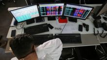 Nifty, Sensex close lower, financials drag