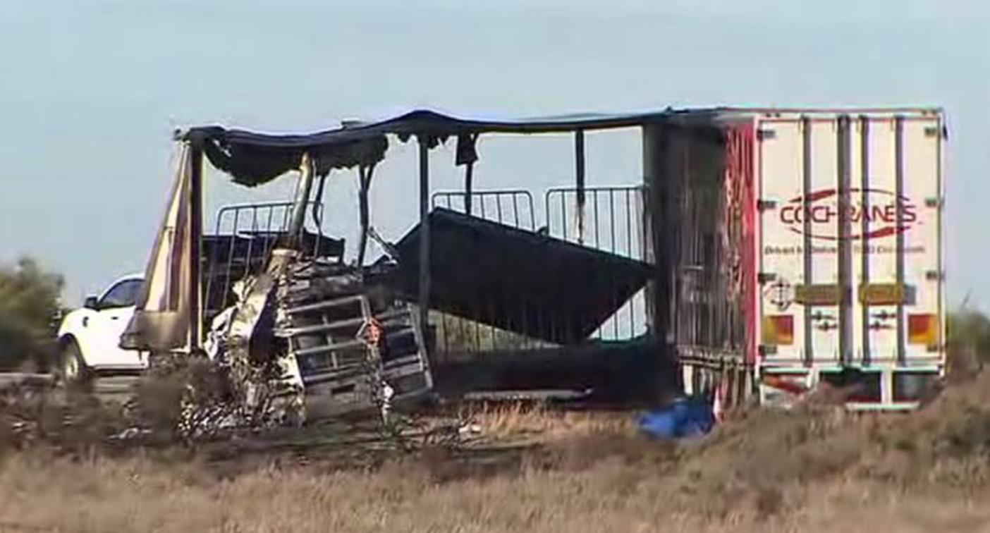 Two people killed after B-doubles collide and burst into flames