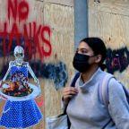 Asian markets mixed as virus, weak data subdue vaccine rally