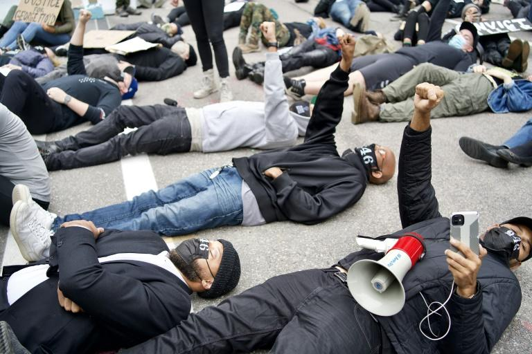 Protesters outside the Hennepin County Family Justice Center in Minneapolis as four former police officers accused of killing George Floyd appeared inside