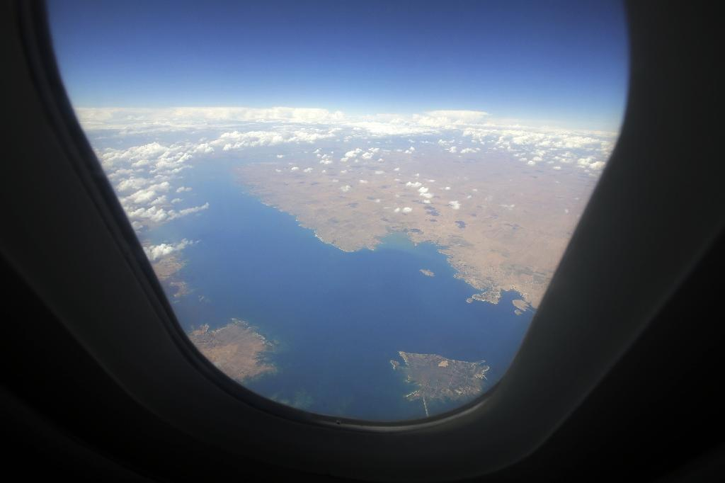 The Euphrates River is seen from the window of a SyrianAir passenger plane as it flies over the Raqa dam in northern Syria on May 15, 2013