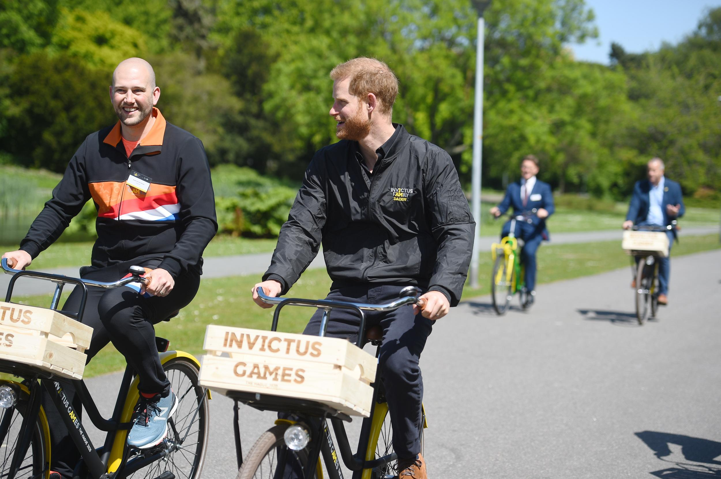 The Duke of Sussex (centre) rides a bicycle during events to launch the one year countdown to next year's Invictus Games in the Hague, in the Netherlands. (Photo by Kirsty O'Connor/PA Images via Getty Images)
