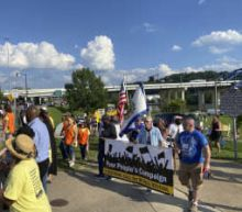 Hundreds protest Manchin over his opposition to voting rights legislation
