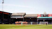 Smoke bomb set off during minute's silence at Luton's match against Watford