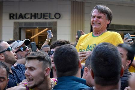 FILE PHOTO: Brazilian presidential candidate Jair Bolsonaro reacts after being stabbed during a rally in Juiz de Fora, Minas Gerais state, Brazil September 6, 2018. Picture taken September 6, 2018. REUTERS/Raysa Campos Leite/File photo