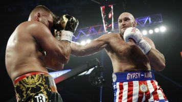 Fury shows no mercy in TKO of Schwarz