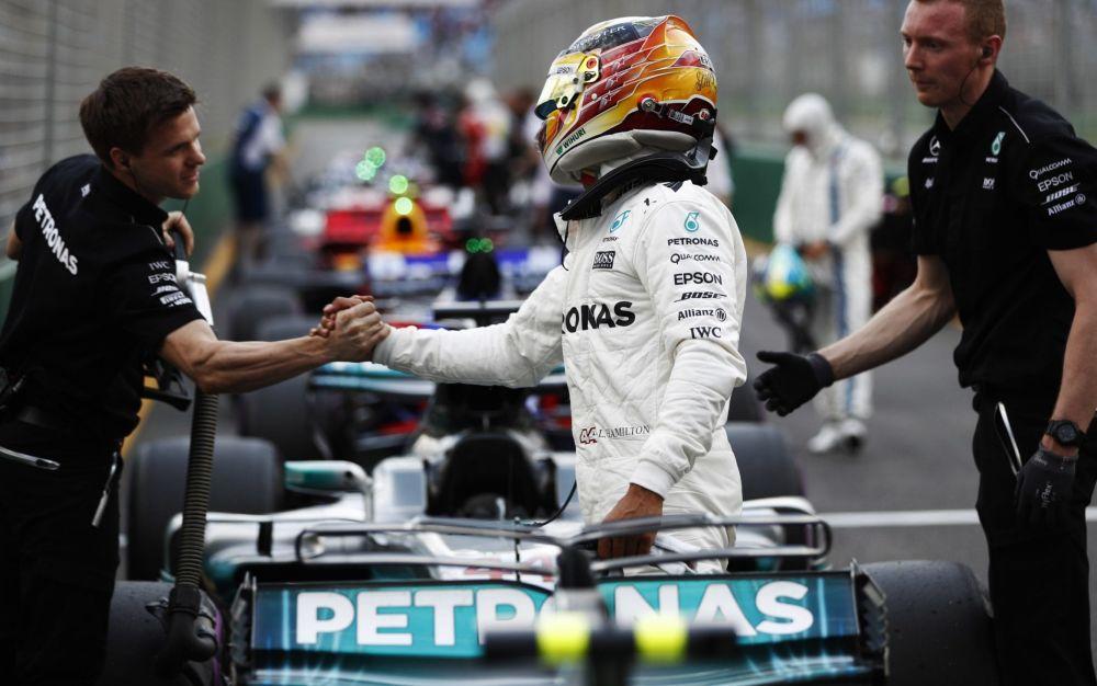 Lewis Hamilton celebrates his pole in Melbourne - Rex Features