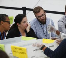 The Latest: Judge rejects suit over Florida mail-in ballots