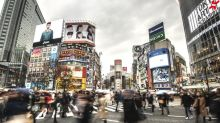 Japan tells workers to stay home to fight crowds