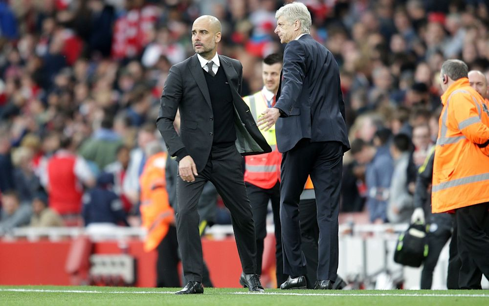 Pep Guardiola and Arsene Wenger (R) will go head to head on Sunday - Rex Features