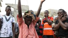 Risk of disease as hundreds queue to identify Sierra Leone mudslide victims