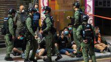 Hong Kong police swoop on postponed poll protests