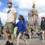 The Latest: Florida's amusement parks loosen mask wearing
