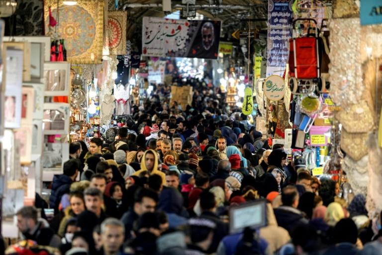 Shoppers in Tehran's Grand Bazaar said they would abstain in this week's elections to express their anger at the country's situation (AFP Photo/ATTA KENARE)